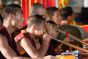Monks in Buddhist monastery blowing on Tibetan dungchen horn