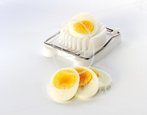 An egg slicer and sliced egg - EggHeadStock