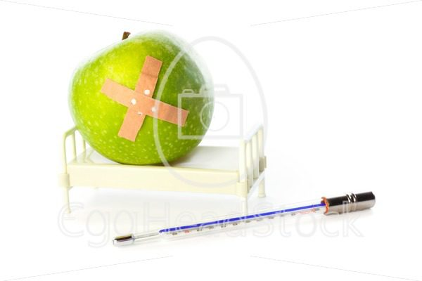 Apple in hospital bed, thermometer in front - EggHeadStock