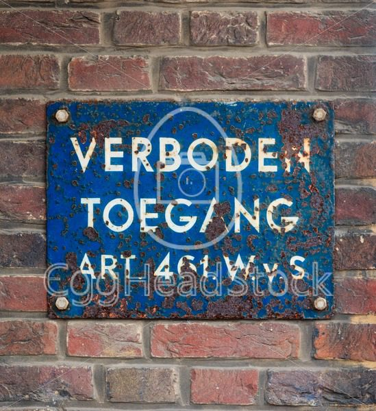 Blue plate with Dutch text 'No Trespassing' - EggHeadStock