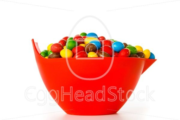 Bowl with colorful chocolate sweets - EggHeadStock