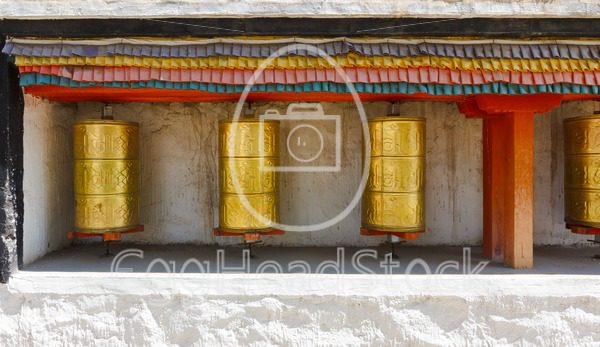 Buddhist prayer wheels at a temple - EggHeadStock