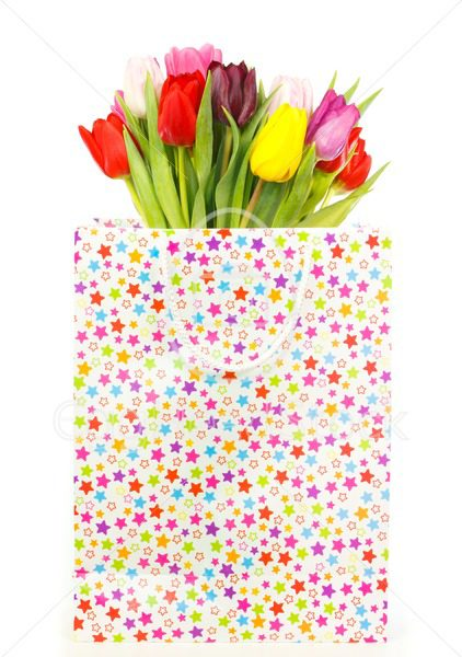 Bunch of colorful tulips in a gift bag - EggHeadStock