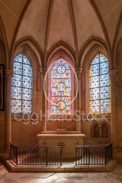 Catholic chapel with altar and colorful stained glass - EggHeadStock