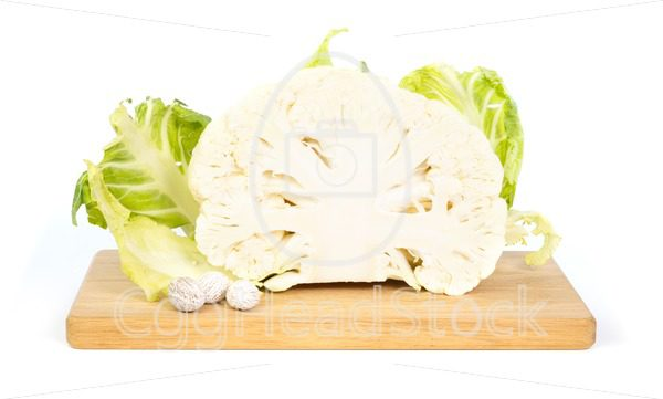 Cauliflower and nutmeg  on a chopping board - EggHeadStock