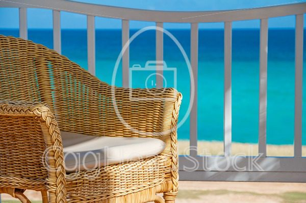 Chair in the shade at a tropical seaside destination - EggHeadStock