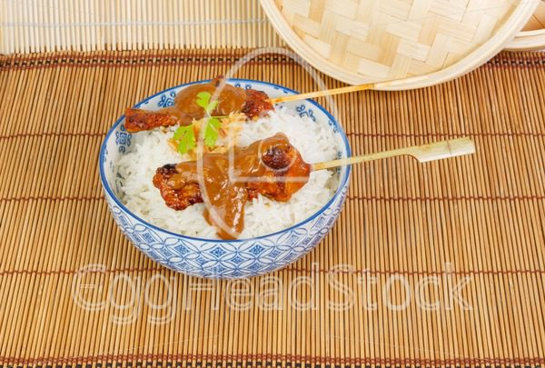 Charcoal grilled pork satay with rice, sauce and fried onions - EggHeadStock
