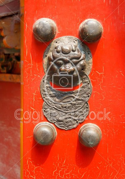 Chinese red door with a dragon head - EggHeadStock