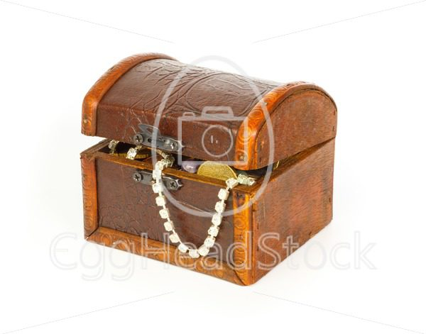 Closed treasure chest with bracelet, coins and pearls - EggHeadStock