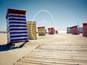 Colorful beach chairs on sunny sand - EggHeadStock
