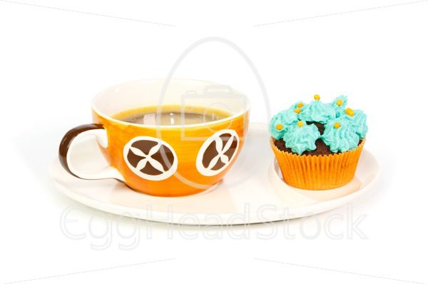 Cup of coffee and cupcake with blue cream frosting - EggHeadStock