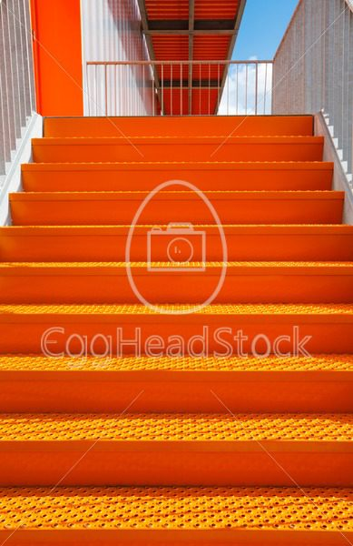 Detail of orange steel stairway - EggHeadStock