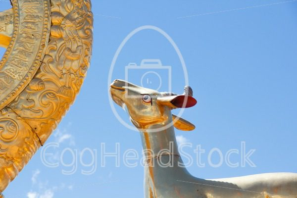 Detail of the rooftop statue of one of the two golden deer flanking a Dharma Wheel on the Jokhang Temple in Lhasa - EggHeadStock
