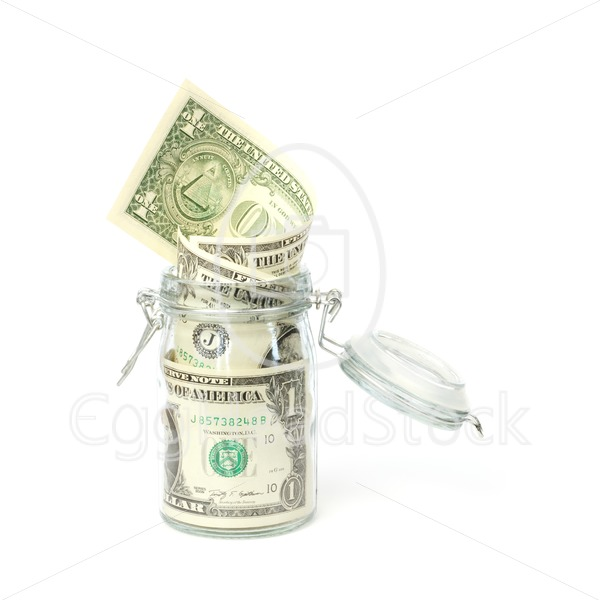 Dollar banknotes in opened jar - EggHeadStock