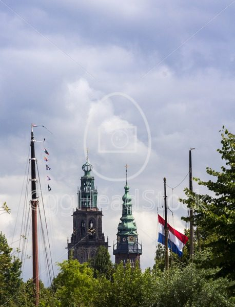 Dutch cityscape with church towers and boat masts - EggHeadStock