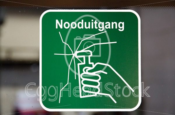 Emergency exit sticker with Dutch text in public transport bus - EggHeadStock
