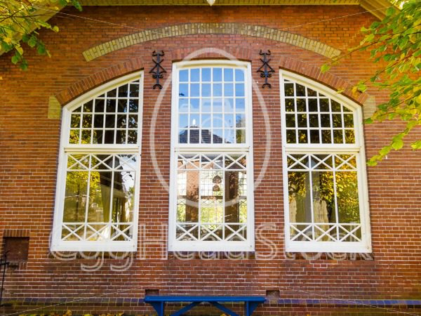 Facade of an old school in the fall - EggHeadStock