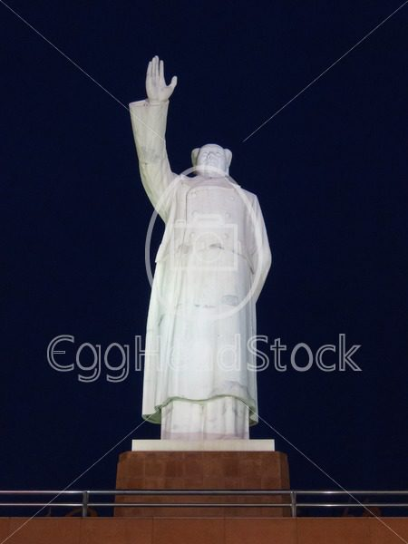 Front view of large Mao Zedong statue at night at the Tianfu square in Chengdu, China - EggHeadStock