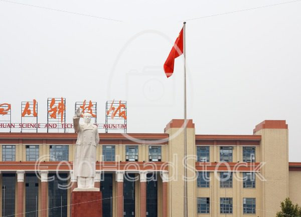 Front view of large Mao Zedong statue during the day at the Tianfu square in Chengdu, China - EggHeadStock