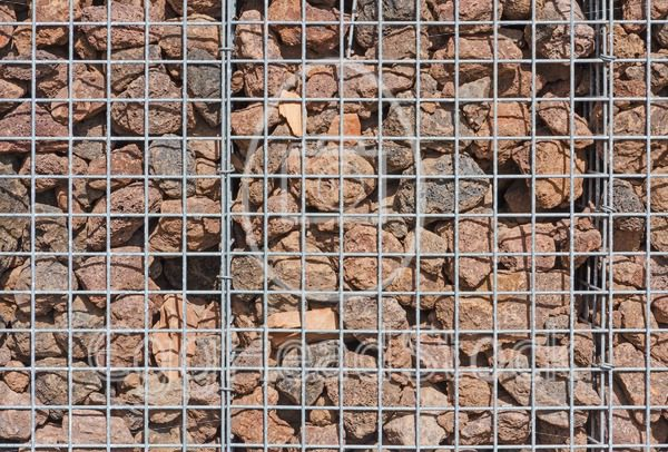 Gabion wall filled with lava stones - EggHeadStock