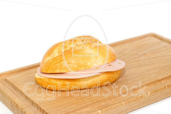 German bread roll with mortadella on breakfast tray - EggHeadStock