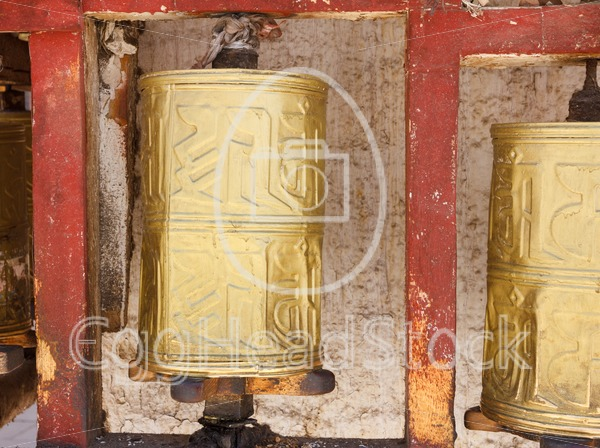Gold colored Buddhist prayer wheel in Lhasa, Tibet - EggHeadStock