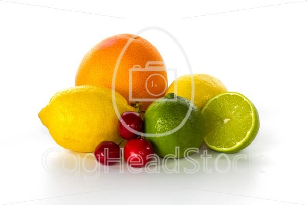 Grapefruit, lemons, limes and cherries still life - EggHeadStock