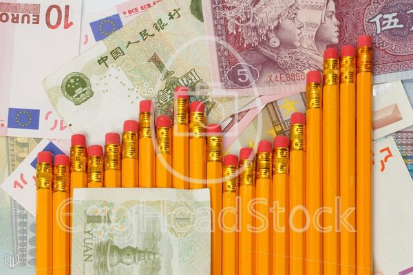 Graph of pencils against background of yuan and euro banknotes - EggHeadStock
