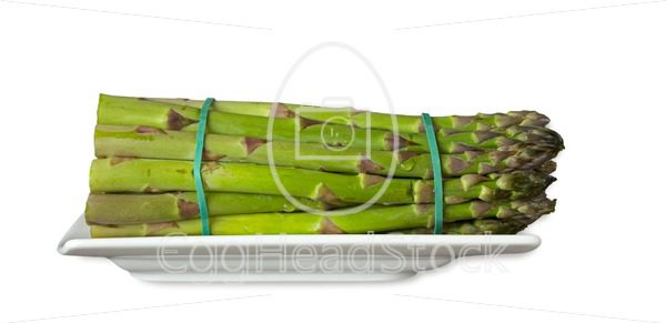 Green asparagus on a plate - EggHeadStock
