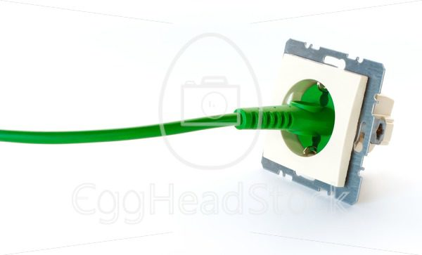Green power cable plugged into wall outlet without cover - EggHeadStock