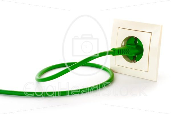 Green power plug into power outlet - EggHeadStock