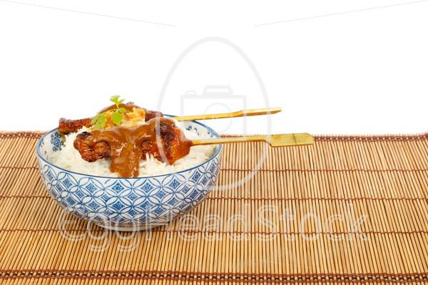 Grilled pork satay and rice against white background - EggHeadStock