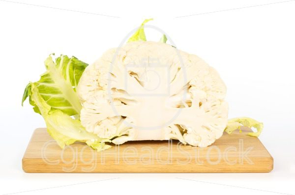 Half a cauliflower on wooden cutting board - EggHeadStock