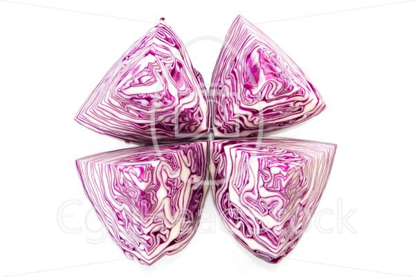 Half a red cabbage cut into four quarters - EggHeadStock