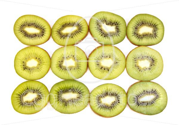 Half kiwi fruit on a row - EggHeadStock