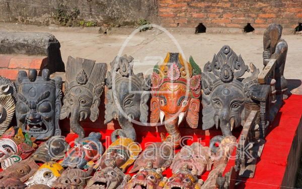 Hand carved wooden masks at market in Patan, Nepal - EggHeadStock