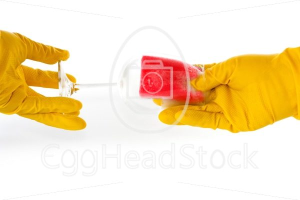 Hands in rubber gloves washing a glass - EggHeadStock