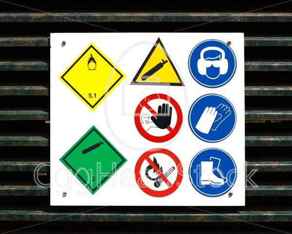 Hazard and safety symbols on door - EggHeadStock