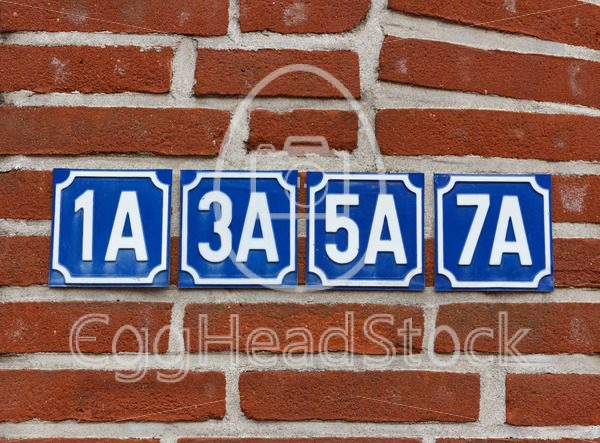 House numbers on wall - EggHeadStock
