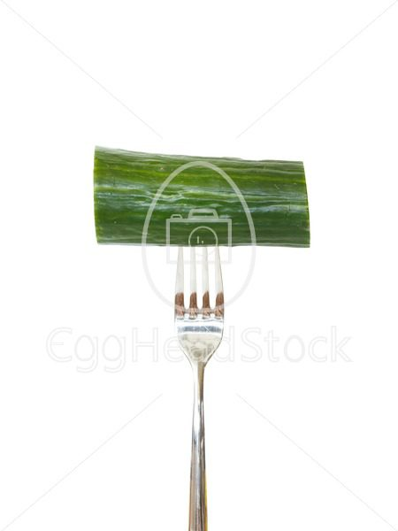 Large piece of cucumber pinned on a fork - EggHeadStock