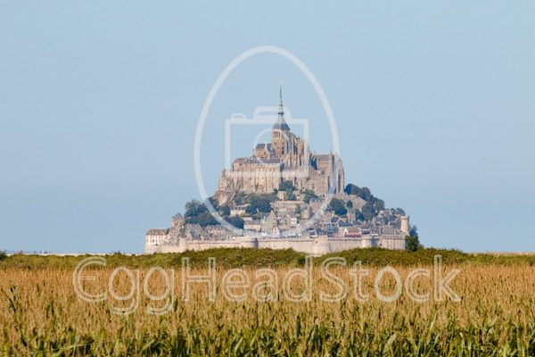 Le Mont Saint-Michel standing out above the cornfield in hot shimmering air - EggHeadStock