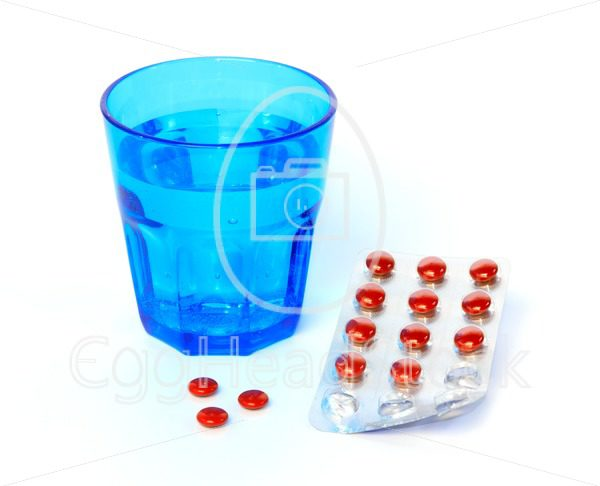 Medicine and a glass of water - EggHeadStock