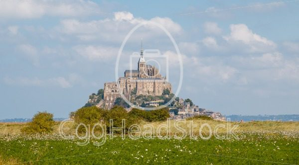 Monastery of Le Mont Saint-Michel rising above the surrounding nature - EggHeadStock