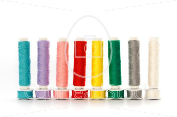 Multicolored sewing threads in a row - EggHeadStock