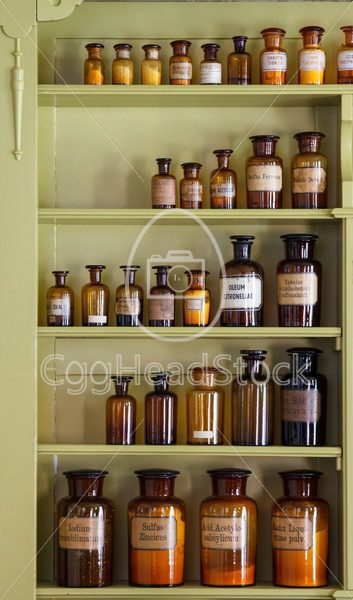 Old apothecary cabinet with storage jars - EggHeadStock