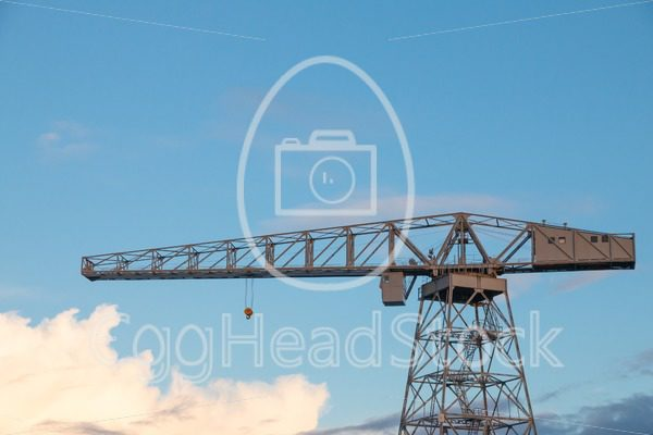 Old crane against sky at sunset - EggHeadStock