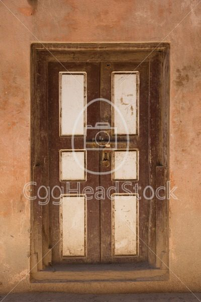 Old panel door with padlock - EggHeadStock