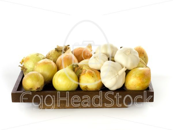 Onions and garlic presented on a wooden board - EggHeadStock