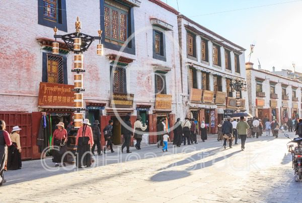 People walking in the  city center of Lhasa, Tibet - EggHeadStock