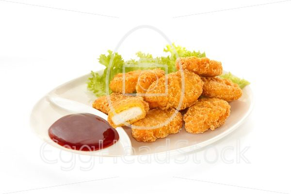 Plate of nuggets with dip sauce, one nugget cut - EggHeadStock